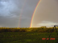 Photo Of A Rainbow Over The Prairie